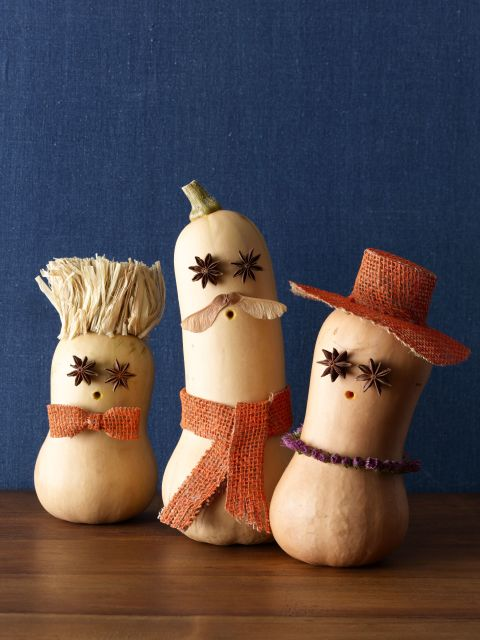 This jaunty trio of butternut squashes wins Best Dressed.Materials• 3 butternut squashes• Star anise• Hot glue gun and glue sticks• Orange burlap• Straw• Screwdriver• Polynose or leaf• Dried flower budsDirections1. Hot-glue star anise for eyes and make mouths with a screwdriver. 2. From orange burlap, create a bow tie and fringed scarf; secure with hot glue. 3. For floppy hat: Trace templates onto colored burlap and cut out. 4. Glue the ends of the rectangle together so they overlap slightly. 5. Once dry, glue this piece to the center of the large circle.6. Glue the small circle on top; let dry.7. Use cut straw for hair, a polynose or leaf for a mustache and dried flower buds to make a necklace; hot-glue in place.