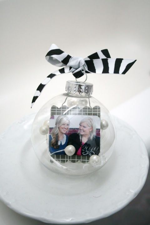 Make this adorable memento using a round plastic ornament, faux pearl beads, foam board and a photo. 