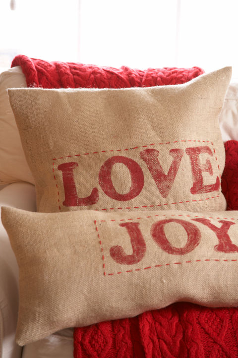 Washable burlap sewn into covers and stamped with paint-covered wooden letters will send the right holiday message.