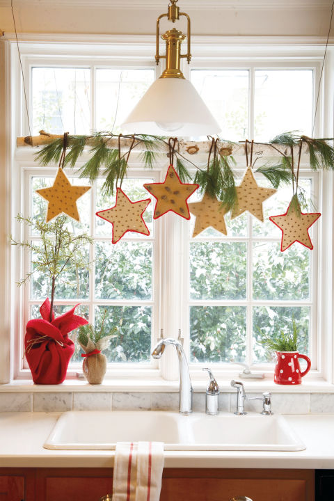 Cut freehand stars out of cardboard and poke cloves through one star for a natural air freshener. 