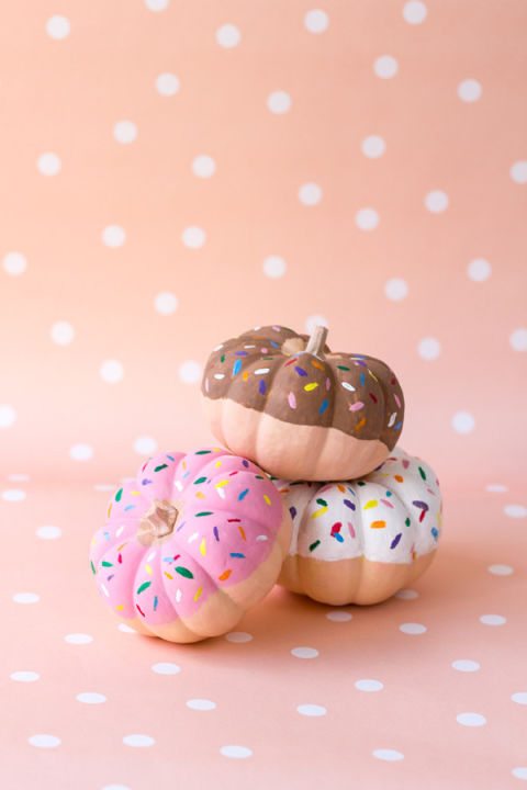 Who doesn't love a good doughnut? Make your own with frosting and sprinkle colored paint. Though these can't be eaten, they'll still add a sweet touch to your kitchen. Get the tutorial at Studio DIY.