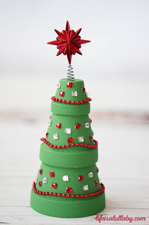 Clay pots make this Christmas tree decoration easy and fun, especially when topped with a bright red star. Get the tutorial at Life is a Lullaby.