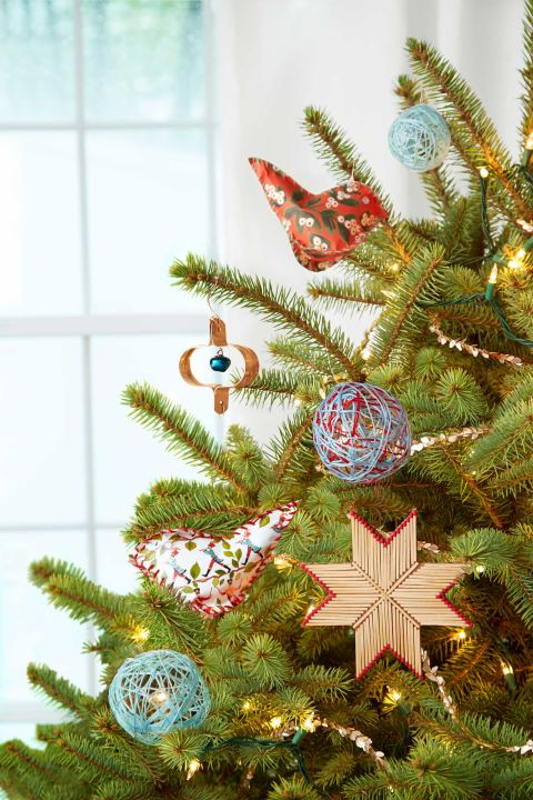 Commemorate Christmas with a keepsake you can make in minutes. These ones were crafted by Carrie Brown, author of The New Christmas Tree. Go to the next slide for the project instructions for each of these ornaments. What you'll need: Christmas ornament hooks ($5; amazon.com)
