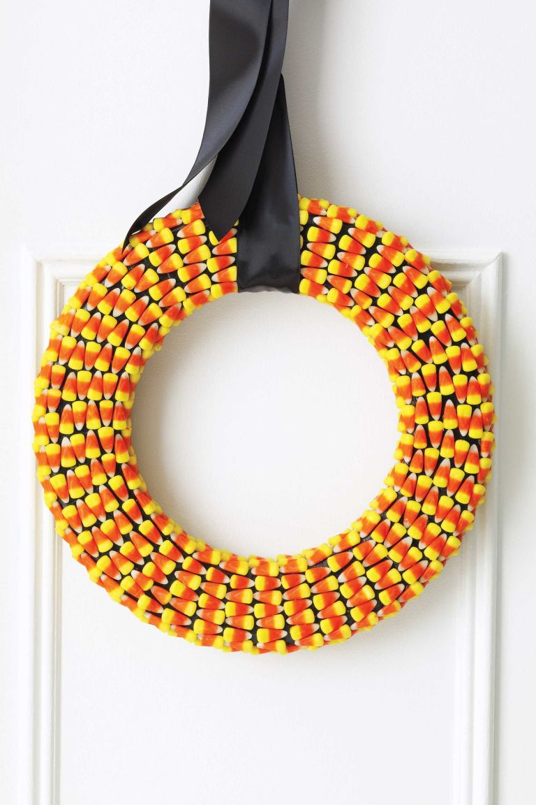 use the popular yellow white and orange confection for this pretty door decoration - Halloween Candy Wreath