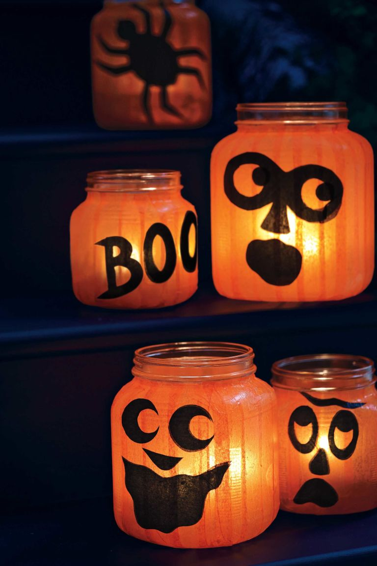 create a quirky patch of pumpkins using round glass holders and tissue paper - Halloween Pumpkin Lights