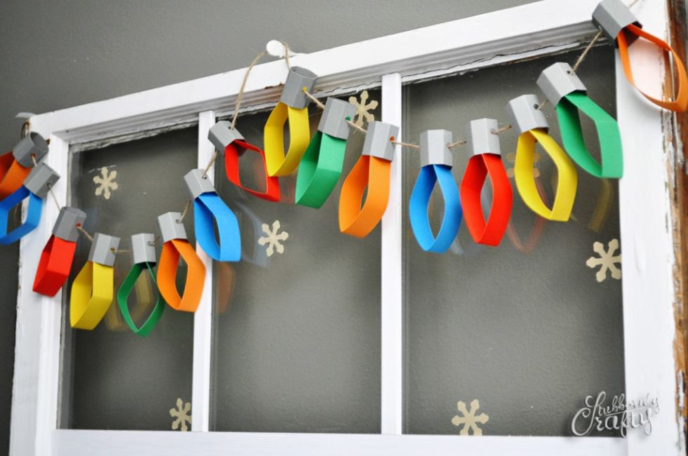 Easily create your own Christmas garland, for any room, with strips of colored stock paper in primary hues.