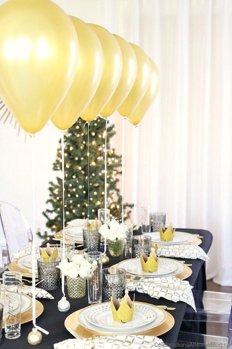 This idea is eye-catching and economical. Tip: Keep balloons from floating away by weighing them down with mini ornament place card holders.  See more at Celebrations at Home.