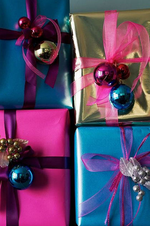 Ornaments aren't just for the tree. Tie some gorgeous ribbons through your favorite holiday balls and wrap them around a brightly colored box. Voila! You already you have a beautiful gift to present under your tree.  Get the tutorial at Older and Wisor.