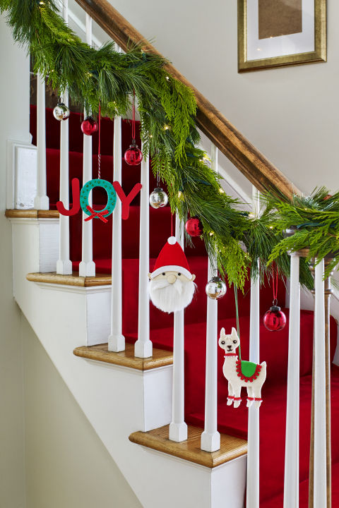 Make extra-special decorations a focal point by hanging them front and center on a staircase banister, or drape your favorites on doorknobs or chair backs.