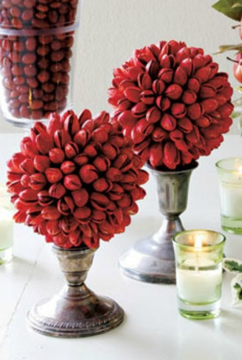 This beautiful centerpiece can be created with pistachios, making it one inexpensive but impressive addition to your Christmas dinner table.