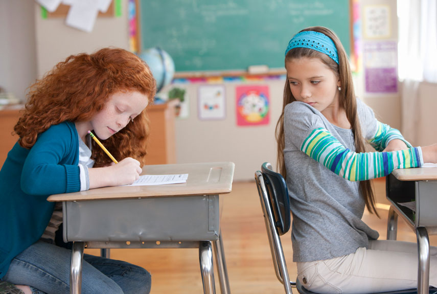 cheating in school signs of academic dishonesty child cheating in a classroom