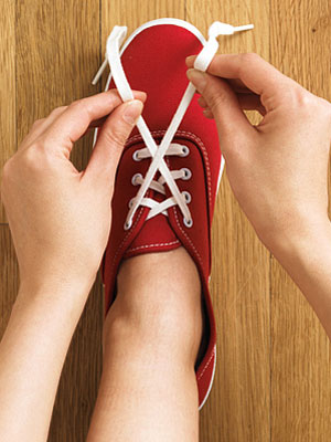 Holding The Shoe Laces In Hand
