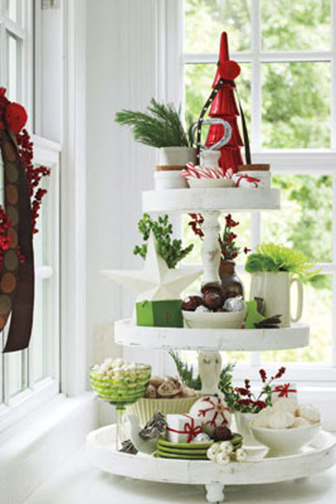 Candies, dazzling greens and keepsakes are irresistible layered on an old-fashioned tiered cake stand. Mix and match shapes and sizes, sticking with colors that mimic those of other kitchen adornments.