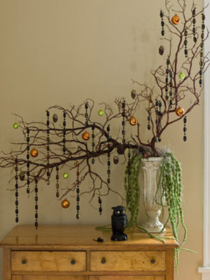 Decorate a table or flat surface with these festive fallen branches
